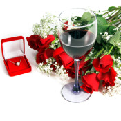 A Dozen red Valentine's Day Roses with babys breath, a heart shaped gold and pearl necklace and a glass of red wine